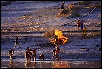 Children bathe in the river and dry out near a fire in a small hamlet. Mekong river, Laos ( color)