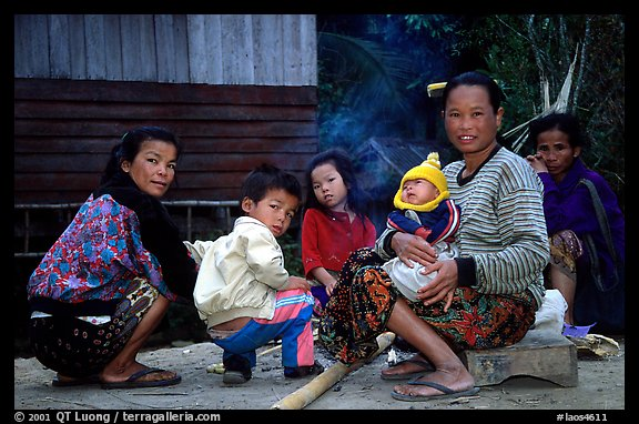 Group of women and children in a small hamlet. Mekong river, Laos (color)