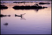 Fisherman casts net at sunset in Huay Xai. Laos (color)