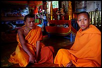 Buddhist novice monks inside temple. Luang Prabang, Laos ( color)