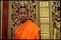 Buddhist novice monk at Wat Xieng Thong. Luang Prabang, Laos (color)