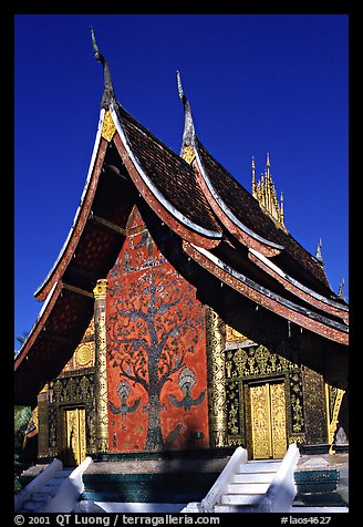 Rear of the Sim of Wat Xieng Thong with mosaic of the tree of life. Luang Prabang, Laos (color)