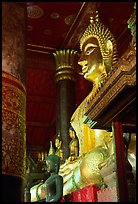 Buddha statues on altar, Wat Xieng Thong. Luang Prabang, Laos ( color)