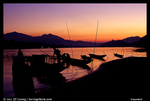 Boats, sunset on the Mekong river. Luang Prabang, Laos (color)