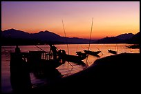 Boats, sunset on the Mekong river. Luang Prabang, Laos ( color)