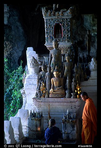 Novice Buddhist monk and vistor in Pak Ou cave. Laos