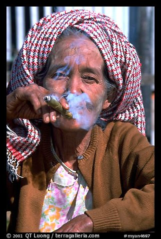 Woman smoking a cheerot,  Kalaw. Shan state, Myanmar (color)