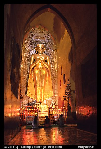 One of four monumental statues inside Ananda pahto. Bagan, Myanmar (color)