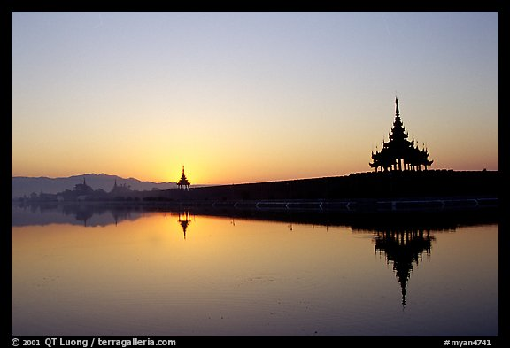 Sunrise on the Mandalay Fort moats. Mandalay, Myanmar (color)