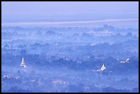 View from the hill through dawn mist. Mandalay, Myanmar (color)