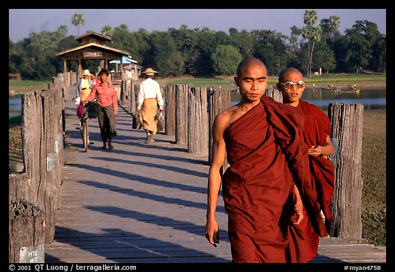 On the two century old U Bein bridge. Amarapura, Myanmar (color)