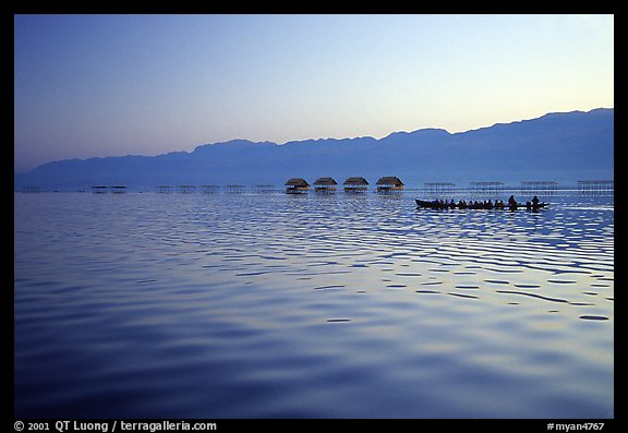 Long boat,  stilts huts, and mountains, sunrise. Inle Lake, Myanmar (color)