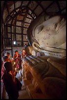 Novices praying in front of Shinbinthalyaung reclining Budddha head. Bagan, Myanmar ( color)