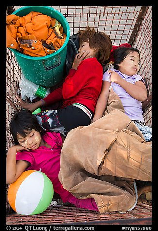 Children sleeping in street cleaning cart. Yangon, Myanmar (color)