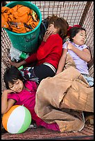 Children sleeping in street cleaning cart. Yangon, Myanmar ( color)