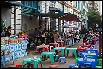 Outdoor eatery sitting on street. Yangon, Myanmar ( color)