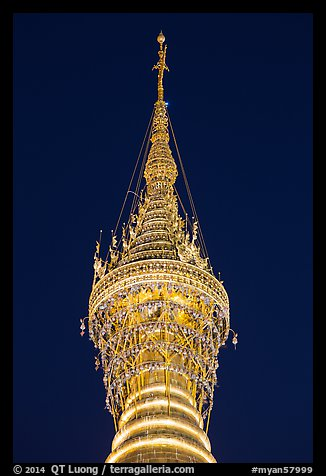 Hti of the Shwedagon Pagoda, adorned with thousands of gems and golden bells. Yangon, Myanmar (color)