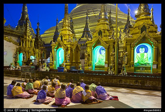 Nuns praying, Shwedagon Pagoda. Yangon, Myanmar (color)