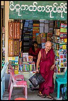 Monk leaves bookstore, Shwedagon Pagoda. Yangon, Myanmar ( color)