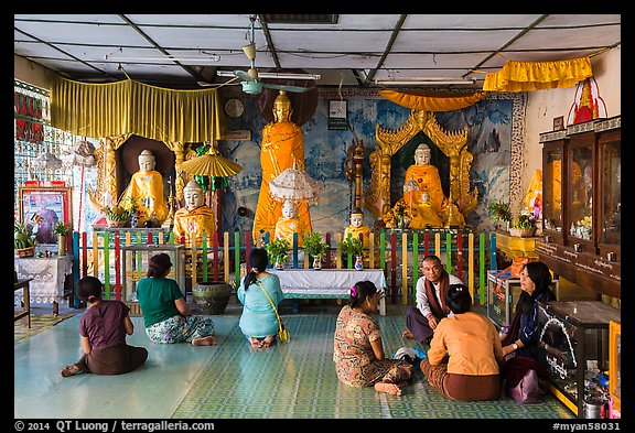 Visitors and altar, Botataung Pagoda. Yangon, Myanmar (color)