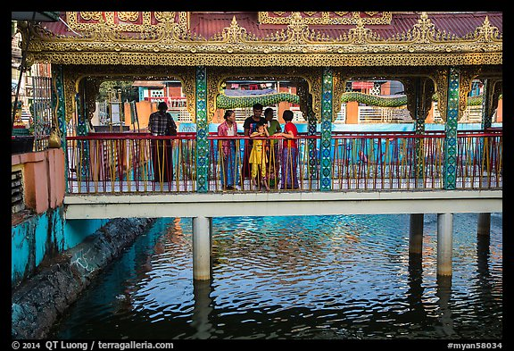 Family at turtle pond, Botataung Pagoda. Yangon, Myanmar (color)