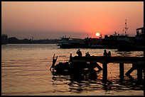 Diving into the Yangon River at sunset. Yangon, Myanmar ( color)