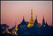 Distant view of Naungdawgyi Pagoda and shrines at dawn. Yangon, Myanmar ( color)