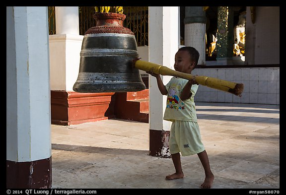 Child ringing bell, Shwedagon Pagoda. Yangon, Myanmar (color)