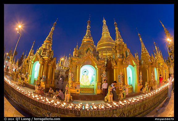 Oil lamps and stupas at dusk, Shwedagon Pagoda. Yangon, Myanmar (color)