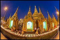 Oil lamps and stupas at dusk, Shwedagon Pagoda. Yangon, Myanmar ( color)