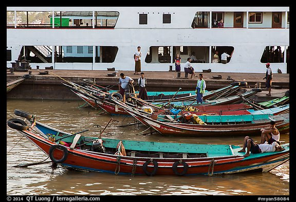 Long-tail boats and ferry, Sinodan pier. Yangon, Myanmar (color)