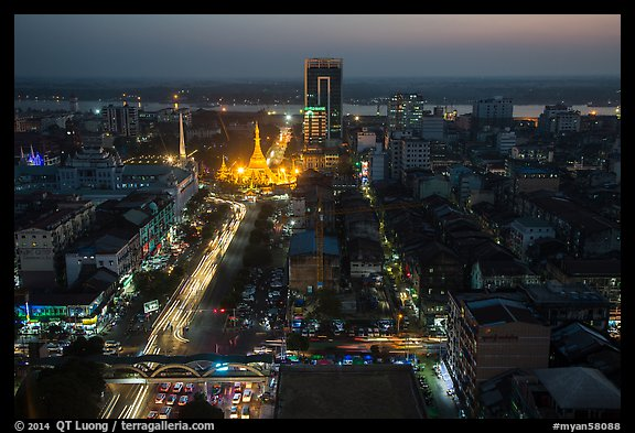 Elevated view of city center at dusk with Sule Pagoda and Yangon River. Yangon, Myanmar (color)