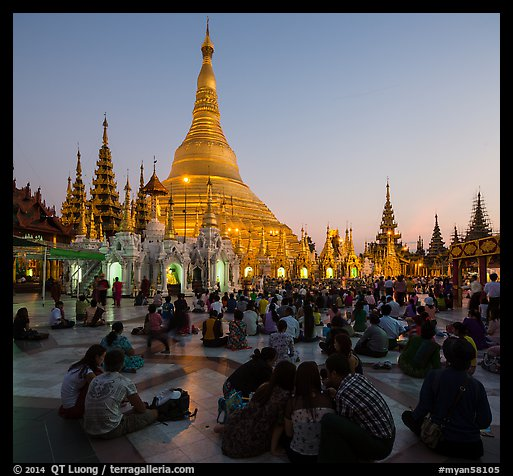 Praying from the Victory Ground, Shwedagon Pagoda, sunset. Yangon, Myanmar (color)
