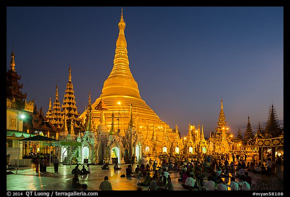 Praying from the Victory Ground, Shwedagon Pagoda, dusk. Yangon, Myanmar (color)