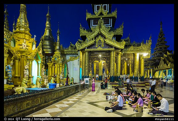 Praying on the platform at night. Yangon, Myanmar (color)
