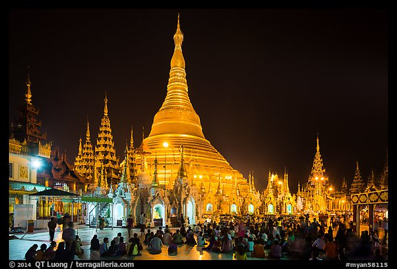 Praying from the Victory Ground, Shwedagon Pagoda, night. Yangon, Myanmar (color)