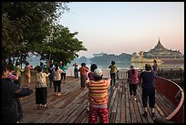 Group practising Tai Chi near Karawiek Hall at sunrise, Kandawgyi Lake Park. Yangon, Myanmar ( color)