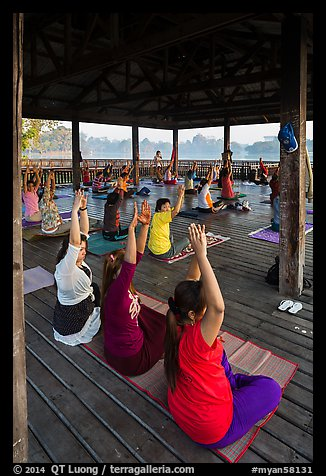 Women exercising in pavillion on Kandawgyi lake. Yangon, Myanmar (color)