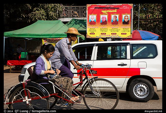 Trishaw, taxi, and billboard promoting monks. Yangon, Myanmar (color)