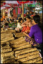 Women selling wood ground to make thanaka. Bagan, Myanmar ( color)