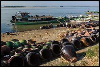 Unloading jars on the Ayeyarwaddy River. Bagan, Myanmar ( color)