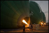 Crew inflates hot air balloons with propane burners. Bagan, Myanmar ( color)