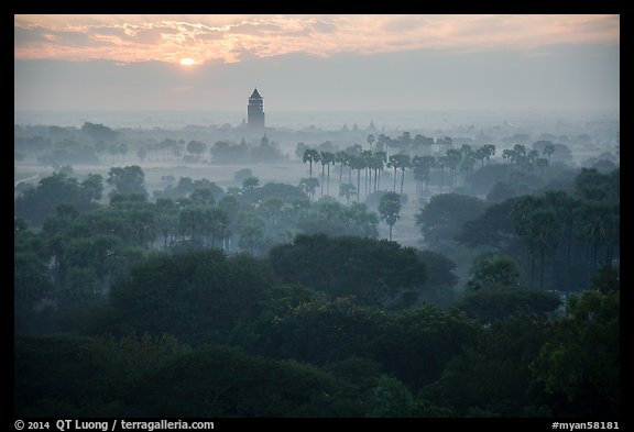 Bagan tower and sun above morning mist. Bagan, Myanmar (color)