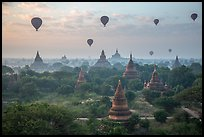 Hot air ballons above temples at sunrise. Bagan, Myanmar ( color)