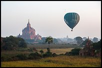 Hot air ballon and Thatbyinnyu temple. Bagan, Myanmar ( color)
