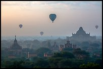 Aerial view of ancient temples and hot air ballons at sunrise. Bagan, Myanmar ( color)