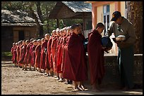 Buddhist novices lining up to receive rice for lunch, Nyaung U. Bagan, Myanmar ( color)