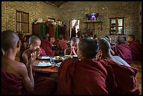 Buddhist novices pray at table before eating lunch, Nyaung U. Bagan, Myanmar ( color)