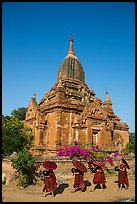 Four novices walk next to temple. Bagan, Myanmar ( color)