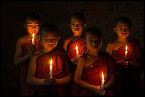 Young buddhist novices holding candles. Bagan, Myanmar ( color)